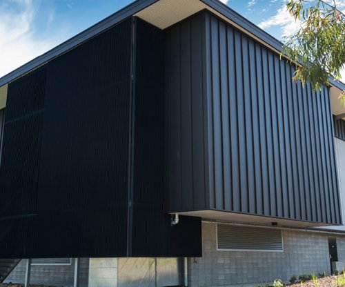 LYSAGHT ENSEAM™ Cladding in COLORBOND® steel Matt finish delivers divine design element for Churches of Christ in Queensland.